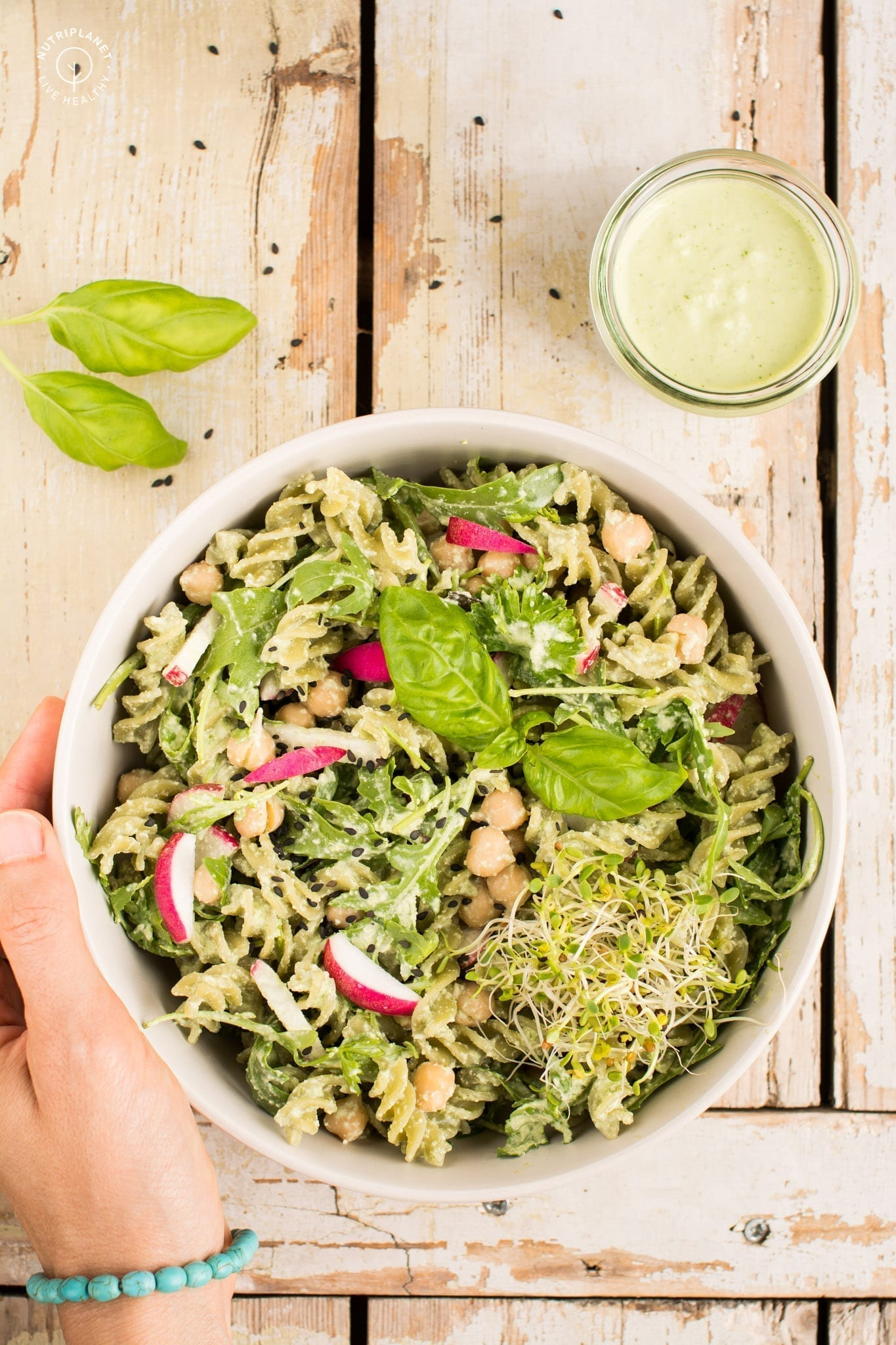 Super easy vegan basil cashew pesto pasta recipe that only requires 10 minutes of your time.
