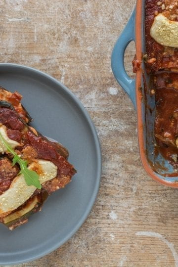 Superbly flavourful vegan tomato zucchini casserole with mozzarella that is oil-free and gluten-free. Excellent Mediterranean vegan recipe for side dish or main meal.